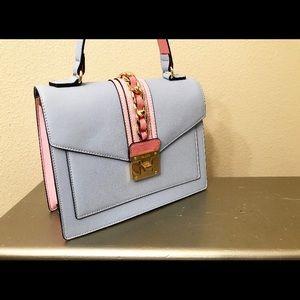 Top handle, crossbody handbag.